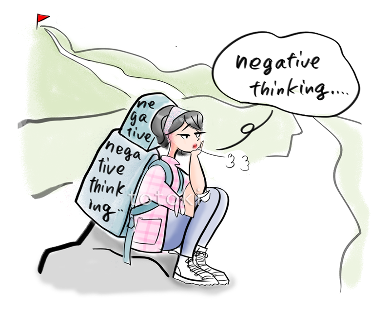 山登りの途中で座り込む女性の姿